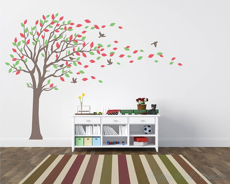 large tree wall decal with colourful leaves blow in the wind nursery